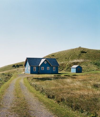 beautiful blue country house makes me want to be in the outdoors in a grassy field