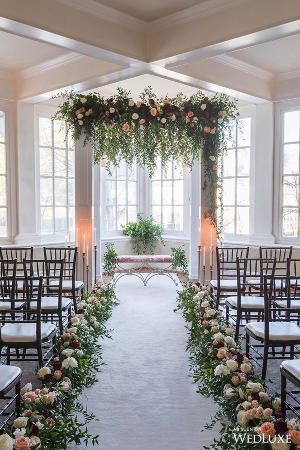 This beautiful trail of flowers leading our eyes to the squared arch with dripping green petals is making us all dreamy. | Langdon Hall | Photography By: 5ive15ifteen Photo Company | WedLuxe Magazine | #wedding #luxury #weddinginspiration #weddingaisle #florals #floralbackdrop