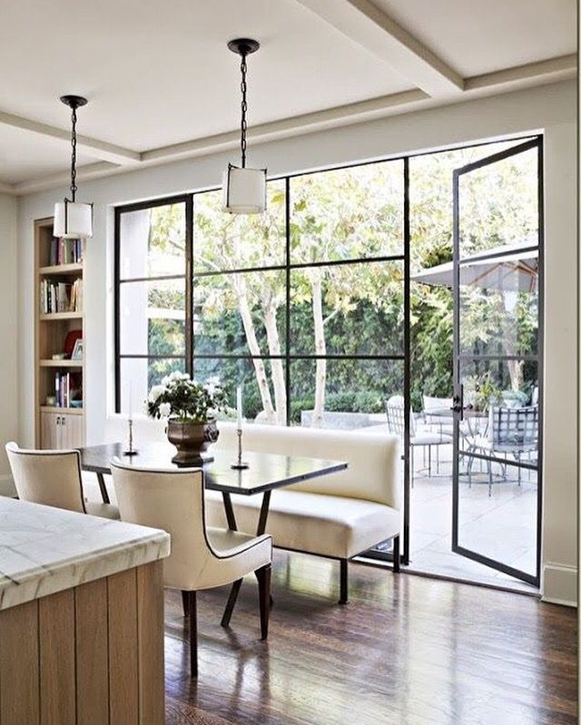 Quaint and simple kitchen design with gorgeous French-style windows and door design.