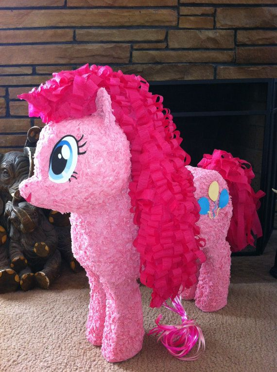 Pink Pony Pinata Custom Made by PinataVille on Etsy, $125.00....in case your looking for another center piece