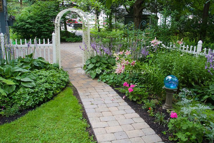 Small Shade Garden With Hostas Lilies Gazing Ball White