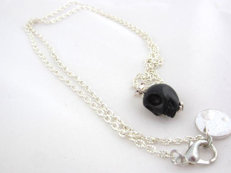 A personal favorite from my Etsy shop https://www.etsy.com/se-en/listing/252283356/black-skull-necklace-in-stone-skull