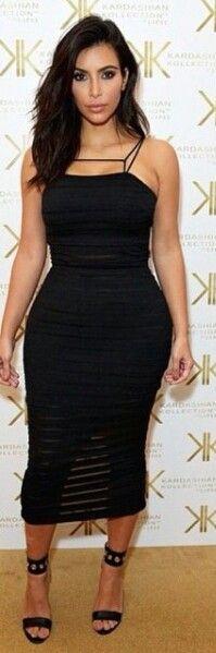 Kim kardashian wearing kardashian kollection dress and shoes