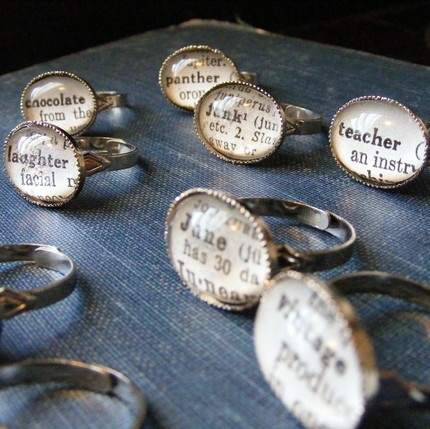 Dictionary Rings; awe shucks i just tossed out an old dictionary for donation; for these type of rings you can use any image and just place in a bezel, and cover with glass cabochon or use a two part resin to cover; to adhere image to glass dome will need some type of diamond glaze