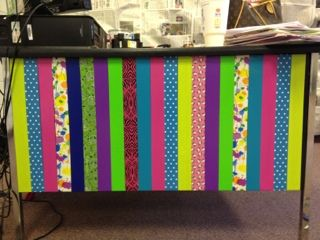 Cute alternative to a table cloth around :) but I would attach all the ribbon to one ribbon and put it on my desk. I saw another teacher do something similar.