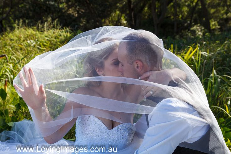 Elope couple kissing under the veil