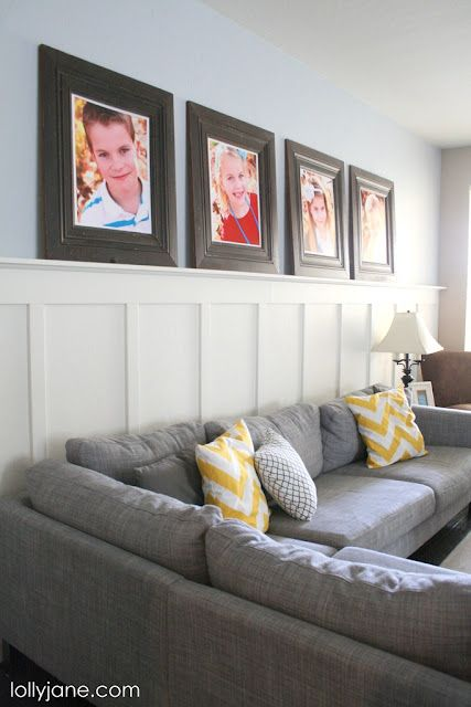 Frames are SO expensive, but this is an alternative.  Use floor moldings (they come primed, just paint whatever color you want), construct them to fit pictures (like Costco's basic poster size).  These frames are 20x24.
