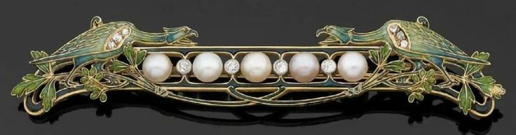 Pierre-Georges Deraisme A rare Art Nouveau gold, enamel, diamond and pearl brooch, about 1910. Designed as two stylised opposing chimeras on branches, decorated with enamel and wings highlighted with diamonds, separated by a line of fine pearls and old-cut diamonds