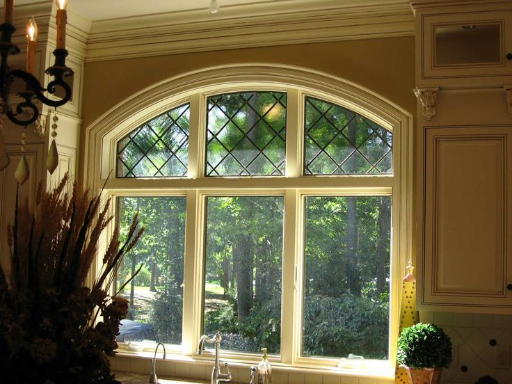 Triple window with decorative black diamond grid in the for Arched kitchen window treatment ideas
