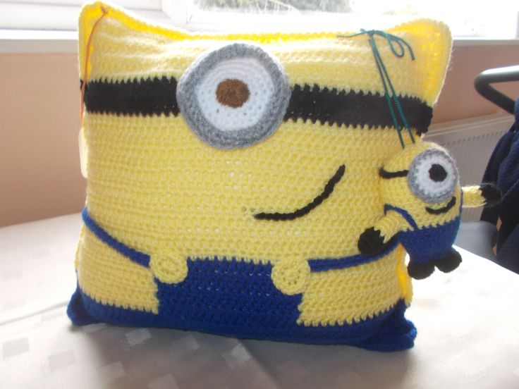 Minion cushion and little minion toy.