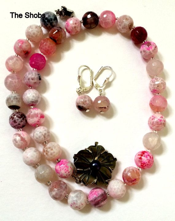 This beautiful Multi-Coloured Agate Gemstone necklace will lighten up your neck fabulously with shell flower hook.Length: 17.5 CMweight of necklace :55gmweight of earring :4gmBead size- 10mm