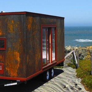 Just in case the beach house is too expensive...just convert a container.  I love the rusted fininsh outside.  See more at  http://su.pr/17GSwoGreen Buildings, Tiny Houses, Dreams House, Small Spaces, Popomo, Moving House, House Projects, Tiny Home, Micro House