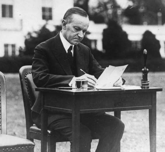 May 26,  1924: PRESIDENT CALVIN COOLIDGE SIGNS IMMIGRATION LAW  -    United States President Calvin Coolidge signs the Immigration Act of 1924, restricting immigration.