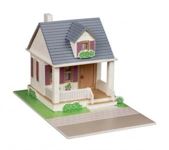 Construcion kit with real bricks of a villa. The building blocks can be reused because the cement is dissolved in water. Contains: construction bricks, cement , wood building components, spatula, bowl, plate and a foam board with figures.