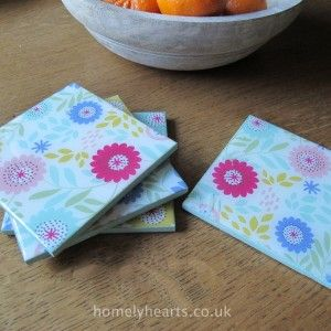 Gloss Floral Song Coaster Set. Set of four wooden coasters by Gisela Graham with gloss finish in bright floral song design.