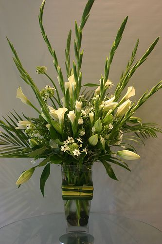 white arrangement- lilies, Callas, ornithogalum, gladiolus while at Garden Party Flowers, Vancouver BC