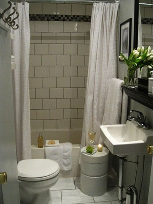 Small bathroom ideas - Home and Garden Design Idea's - Tiled tub / shower combination, modern pedastal sink