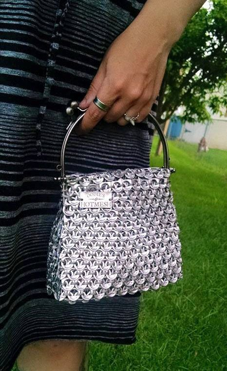 Made to order (2-3 weeks for production) Vintage inspired handbag constructed out of recycled soda tabs bound together with nylon cording. This purse is available in either double-sided tabs, or a liner to match color of nylon binding. Super soft and pliable. Perfect size for a day or night out. Plenty of room for phone, keys, sunglasses, wallet. The base is approximately 4 inches by 7 inches. Handle is 6 inches wide, available in gunmetal, shiny silver or black finish. Your choice of color…