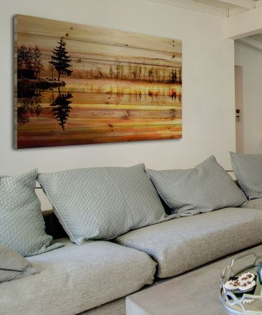 Enjoy a lakeside retreat from the comfort of home by hanging up this stunning handcrafted wall art