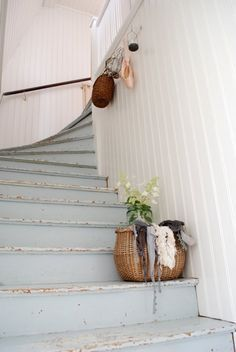 love the blue scuffed stairs.  Relaxed and friendly for wear and tear of a family.                                                                                                                                                                                 More
