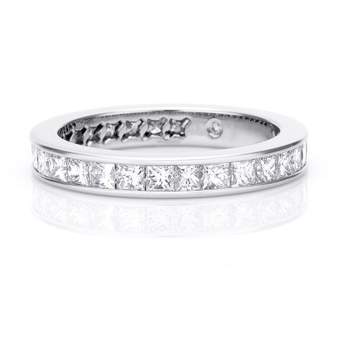"""Brides.com: Platinum Wedding Rings for Women. Style 8244, """"Channel-Set Full Eternity Wedding Band,"""" set with princess-cut diamonds, 3mm in width, $6,000, De Beers  See more De Beers wedding rings."""
