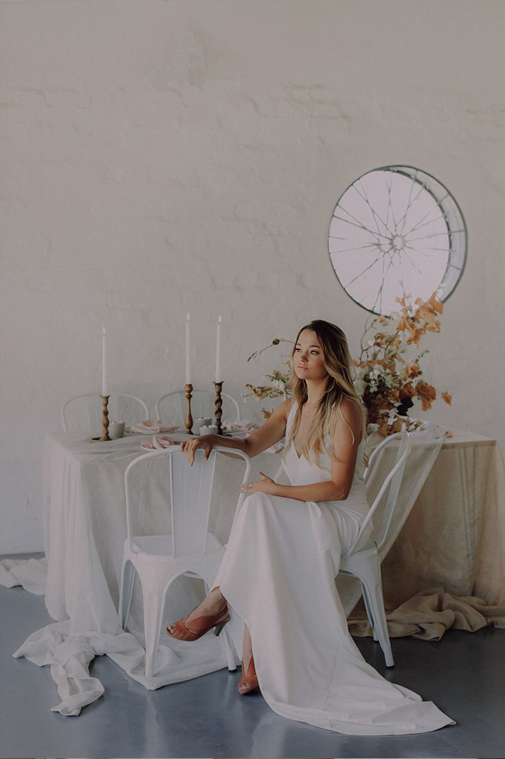 Simplistic wedding decor inspiration with natural elements and a neutral palette. Wedding trends 2018  Decor by Kadou.  Stationery by Fleur Design Studio Venue: The Styling Shed Hiring: Grand Room Design Makeup & Hair: Clarita Smit Makeup & Lashes Dress: Janita Toerien