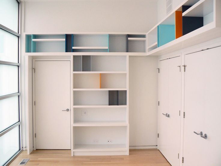A residence we completed in Highland Park, IL. Office was decked out in custom Mondrian inspired shelving units to max out the book storage for this client.