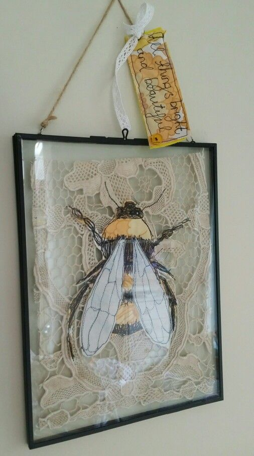 Textile art freemotion machine embroidery bumble bee on vintage lace by Emily Henson.                                                                                                                                                      More