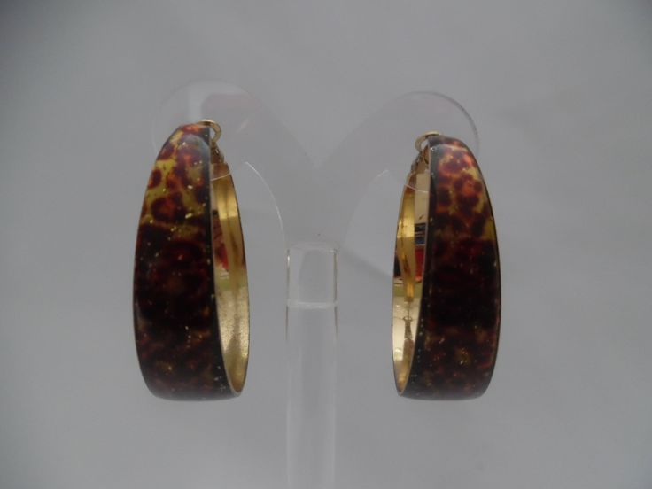 "Pierced gold, brown, orange & black animal print earrings 2""  $10.99 https://hipandcoolcliponearringstwo.com"