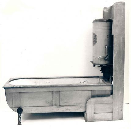 """ca. 1880-1900, """"The Closet Folding Bathtub"""" manufactured by the Mosely Folding Bath Company  With daily bathing becoming more accepted by th..."""