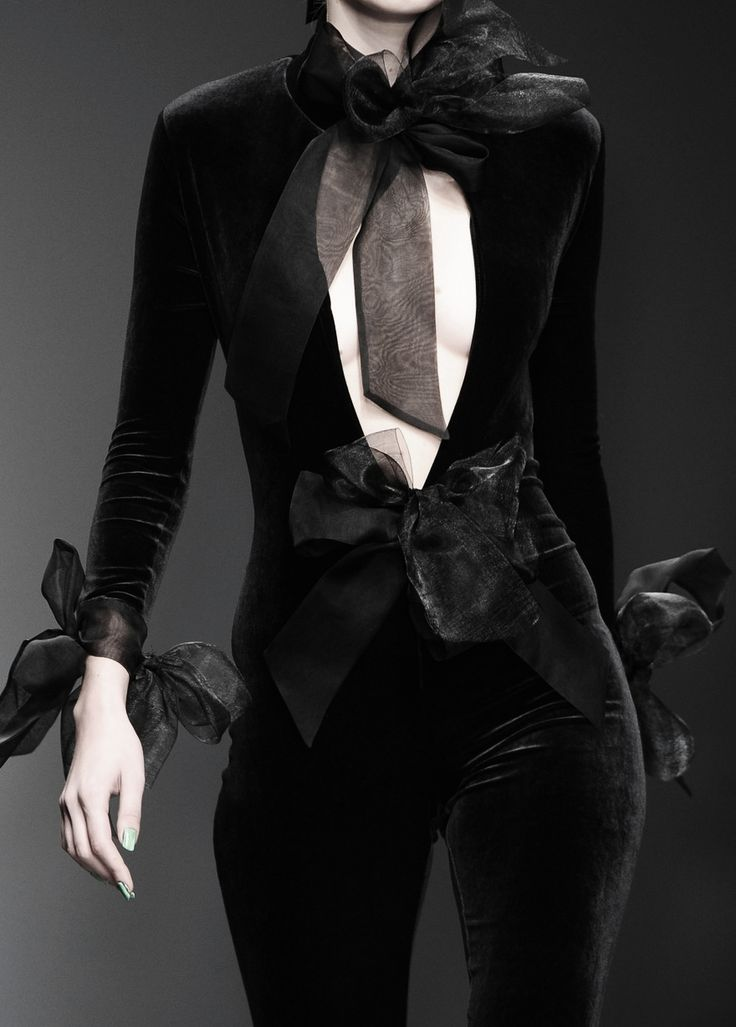 Change the velour to a more-luxurious velvet (eliminate the Catwoman vibe), add edgier texture or detail to the generic ribbons. I like so much about this, though.