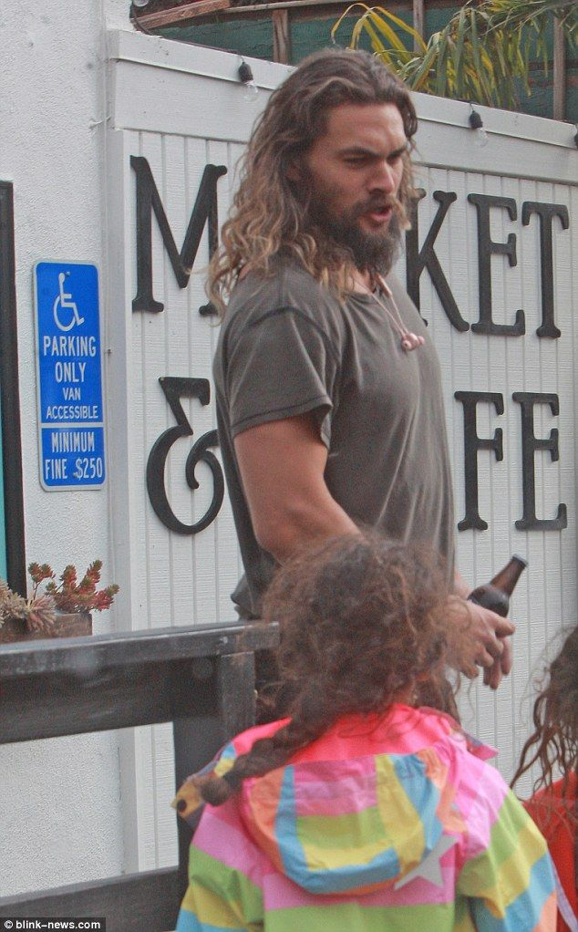 Family man: On Saturday, Jason Momoa was spotted out and about in Los Angeles with his wife Lisa Bonet and their two children, Lola, nine, and Nakoa, eight