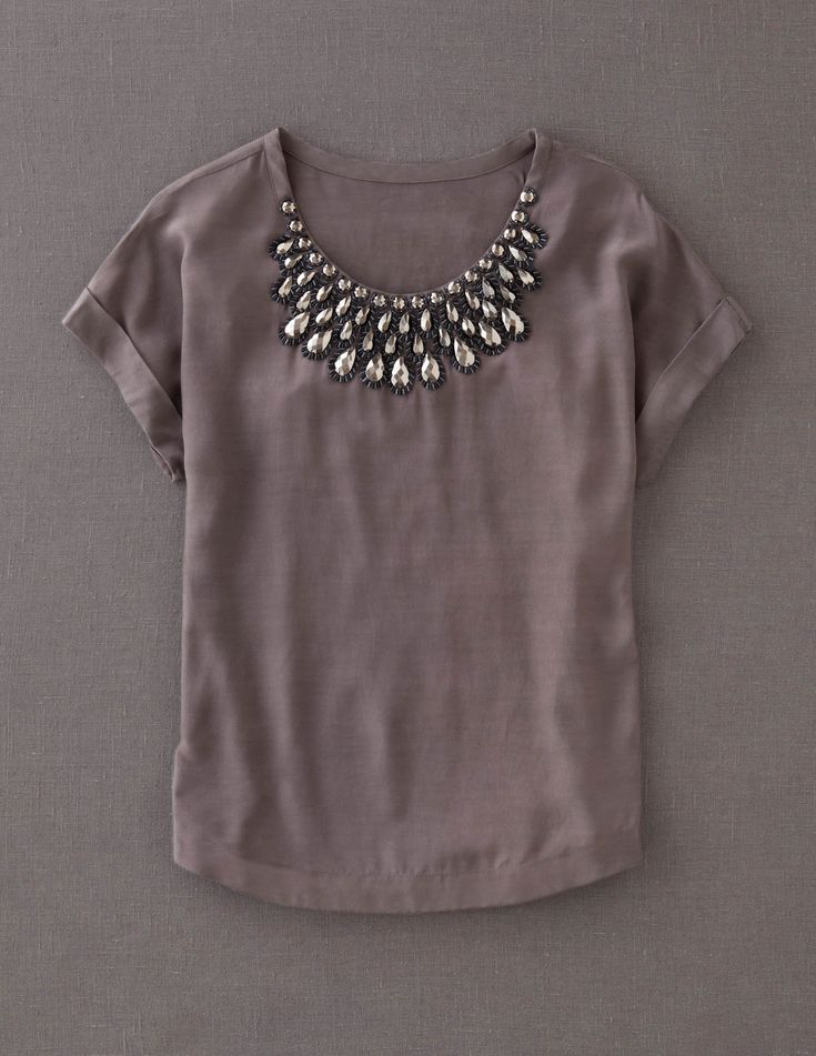 Jewel Neckline: Round neckline that makes a good background for jewelry and necklaces.super dressy for me buy its cuteee