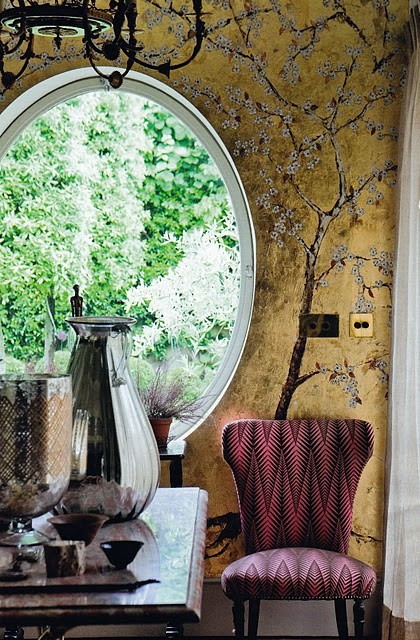 Adore the wallpaper and the window.: Cherries Blossoms, Wallpapers Round Window, Wallpaperround Window, Living Rooms, Features Wall, Chairs, Interiors Design, Gold Wall, Oval Window