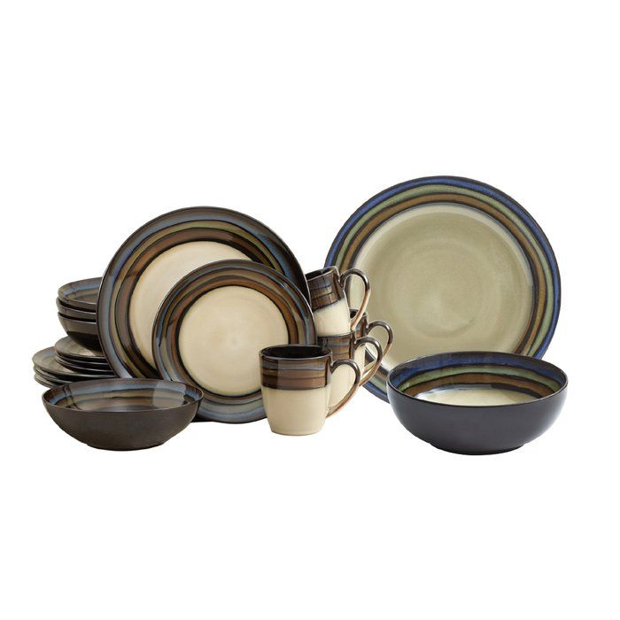 Traditional earth tones of beige and brown are accented by complimenting colors of blue and green. Each piece is banded by a stripe pattern that perfectly coordinates with the design and palette of the body. 16 Piece dinnerware set, service for four, includes (4) each: dinner plate, salad plate, soup bowl and coffee mug.
