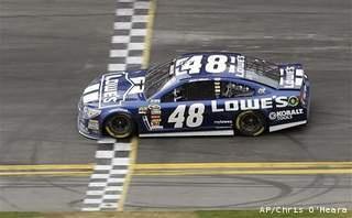 Jimmie Johnson crosses the finish line to win the Daytona 500 NASCAR Sprint Cup Series auto race, Sunday, Feb. 24, 2013