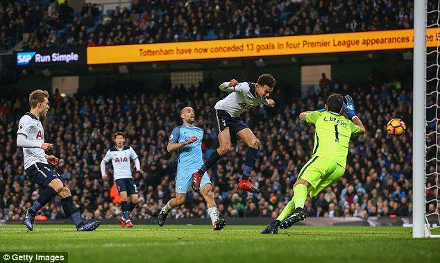 Dele Alli heads past Claudio Bravo to cut Manchester City's lead to 2-1 on Saturday