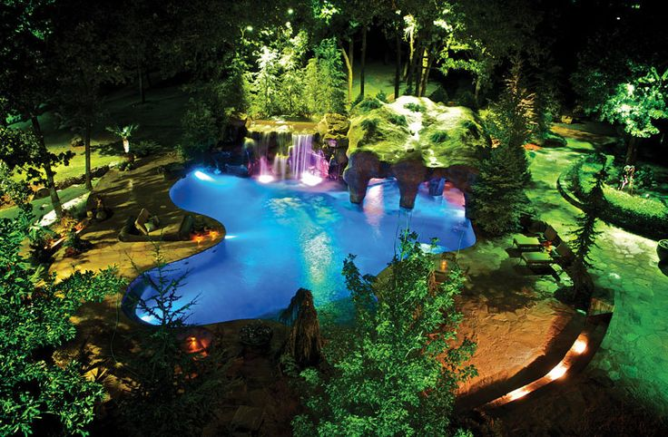 This enchanting lagoon-style pool features three waterfalls and a 900-foot grotto! Caviness Landscape Design, Edmond, Oklahoma. Photography by K.O. Rinearson­ http://www.luxurypools.com/articles/secret-hideaways-caves-and-grottos.aspx