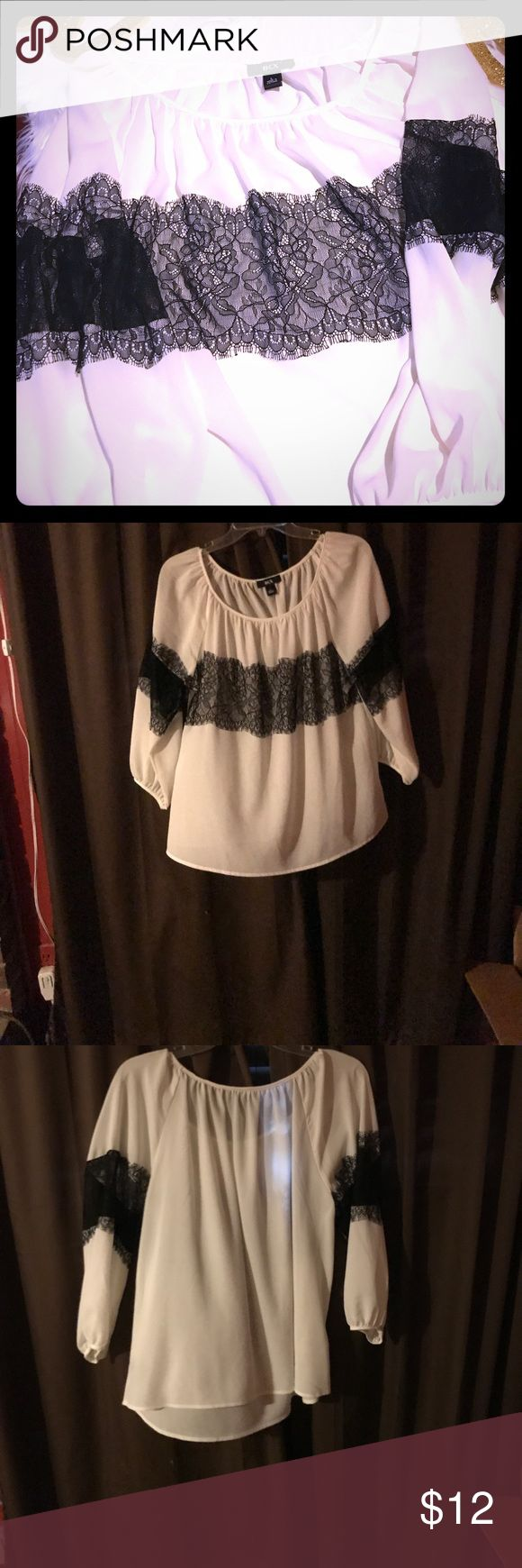 BCX white and black blouse BCX white flowing blouse accented with black lace. Purchased from Macy's. Wore once. Perfect condition. Size large BCX Tops Blouses