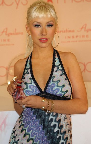 """Christina Aguilera Photos - Recording artist Christina Aguilera poses for photographers during an autograph session and the launch of her new perfume """"Inspire"""" at Macy's Glendale Galleria on December 5, 2008 in Glendale, California. - Launch Of Christina Aguilera's """"Inspire"""""""