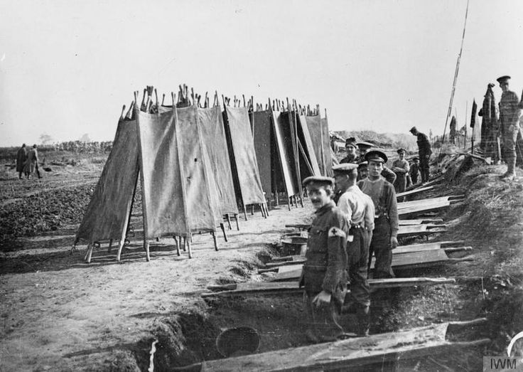 British stretcher bearers drying their stretchers at Bronfay Farm, near Bray-sur-Somme, 23 September 1916.