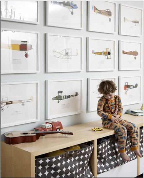 symmetrical airplane gallery wall + dotted play storage baskets