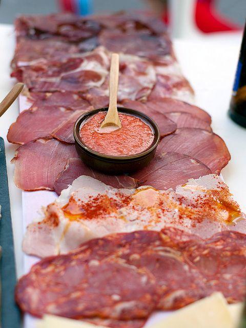 Spanish tapas: cecina (curing beef), jamón ibérico, lomo (loin), lacón (ham), chorizo, queso de oveja (cheese sheep's milk), tomate (tomato ...