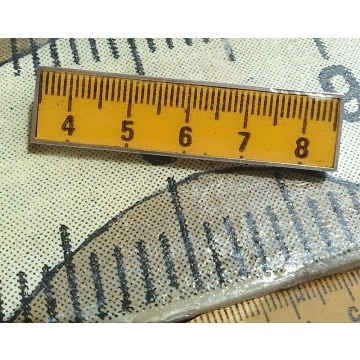 Size matters? This Centimeter Brooch is also a Pendant. A vintage ruler encased in resin and set in sterling silver by an artisan in Florence, Italy. For a mom who measures up to the best!