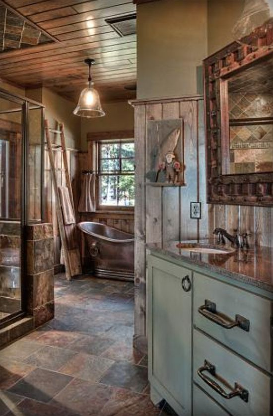 love the copper tub in this rustic log cabin bathroom