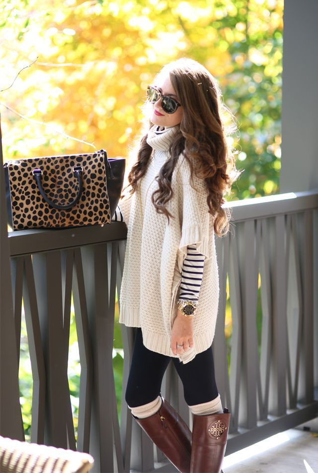 white and dark blue horizontal striped turtleneck sweater, light beige oversize pullover, brown leather knee high boots, brown leopard leather satchel bag for women
