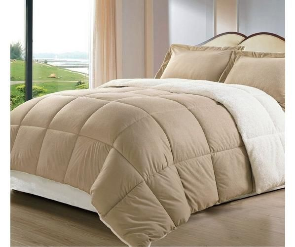 Snuggle up under this Sherpa blanket and stay warm all winter. This reversible Down Alternative Comforter Set features soft Sherpa/Berber material on one side and super micro fiber polyester on the other side. The blanket is available in your choice of Twin, Full/Queen or king Sizes.
