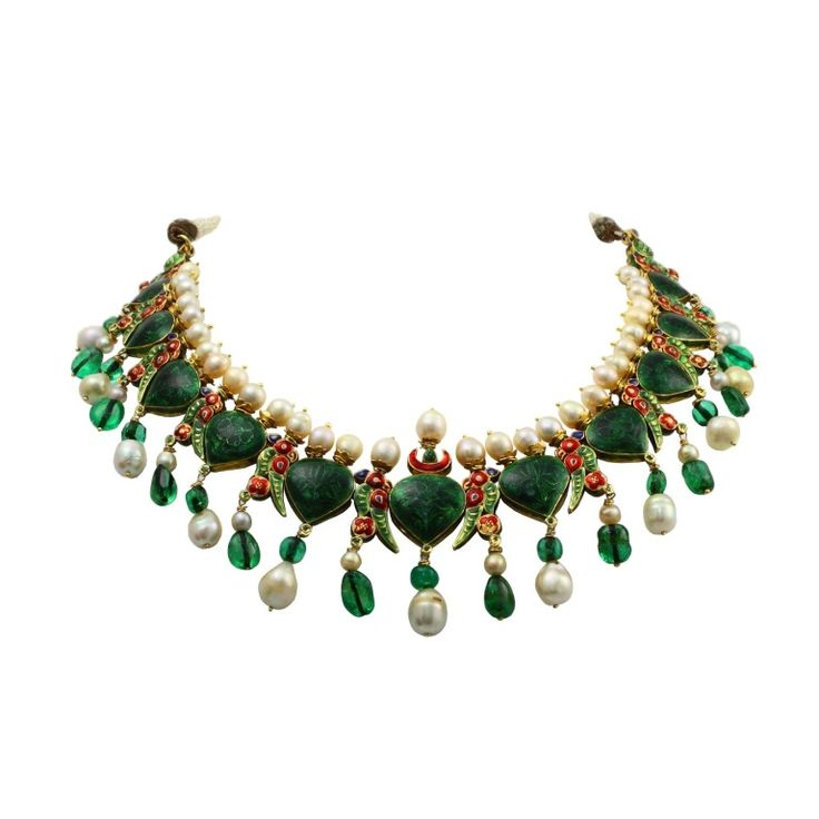 An impressive, vintage, and royal Indian enamel necklace with natural saltwater pearls, old-mine Colombian emerald beads, and large rose cut diamonds. The estimate weight of the diamonds is forty-five to fifty carats. The necklace is presumed to be over 100 years old and is in pristine condition.  (reverse)
