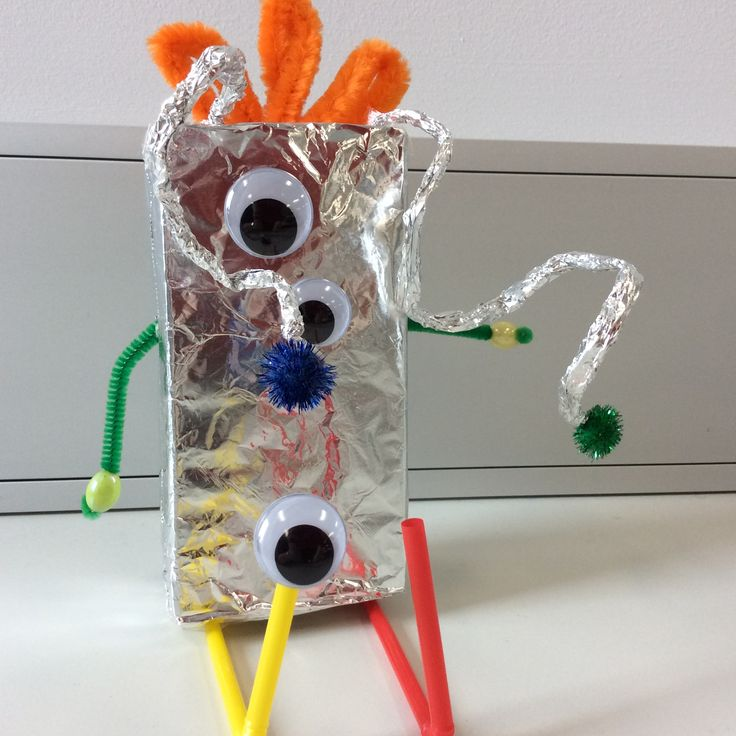 robot alien cover small boxes with foil pipe cleaners and straws for arms an legs add pom poms and eyes for personality!