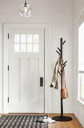 The slender shape of this coat rack adds modern storage that's perfect for small spaces. Eight offset hooks hold a variety of jackets and hats with ease.